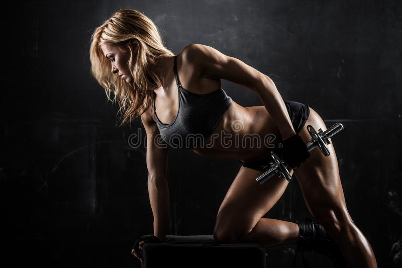 Athletic woman with dumbbells stock image