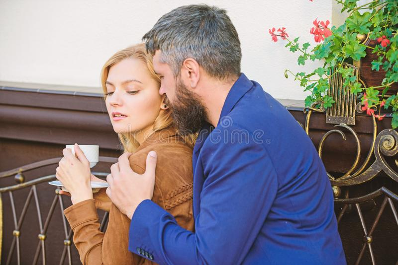 Brutal bearded hipster and girl drink coffee. Morning coffee. First meet of girl and mature man. woman and man with stock photos