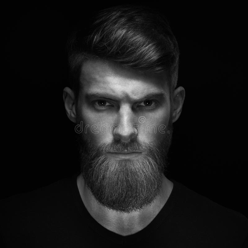 Brutal bearded man in a black T-shirt royalty free stock photo