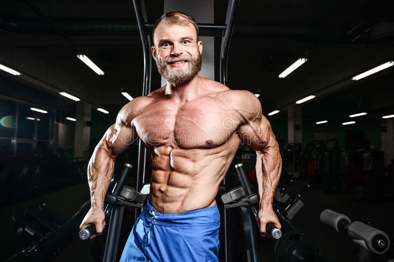 Brutal caucasian handsome fitness men on diet training chest pumping stock images