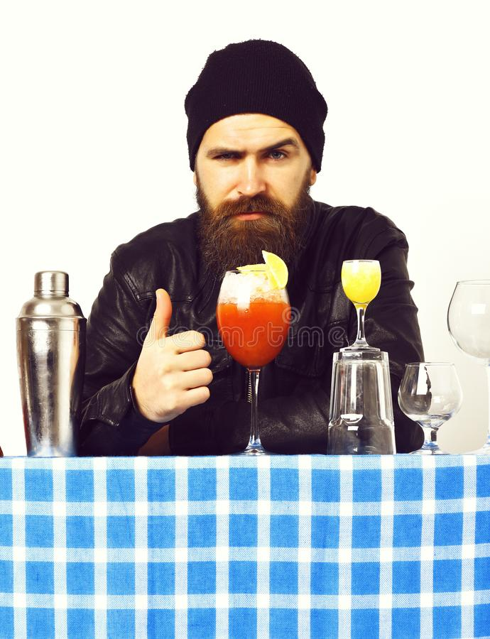 Brutal caucasian hipster with alcoholic beverage or fresh cocktail royalty free stock photography