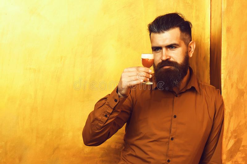 Brutal caucasian hipster holding alcoholic shot stock images