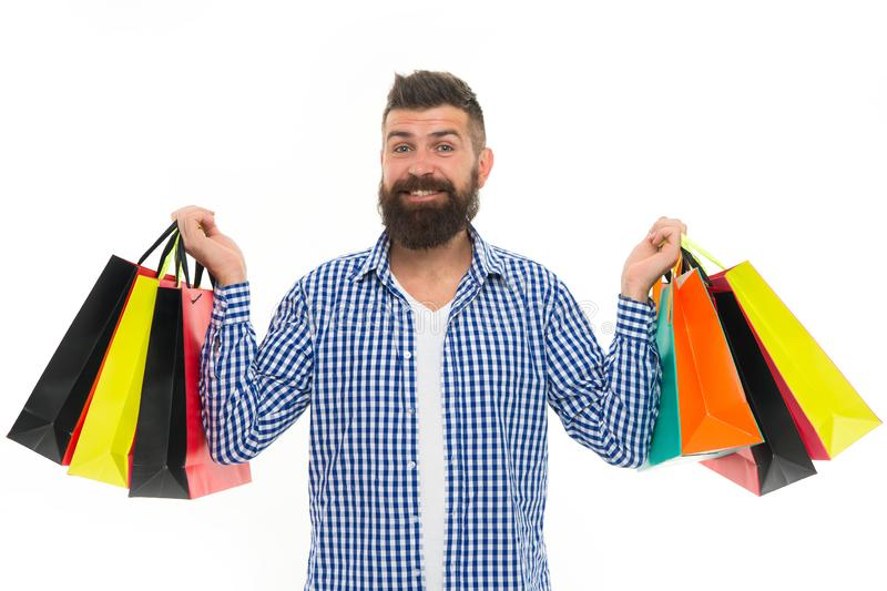 Brutal caucasian hipster with moustache. Bearded man with shopping bags.. Shopping sale. Male barber care. Black Friday. Cyber Monday. Mature happy hipster royalty free stock photography