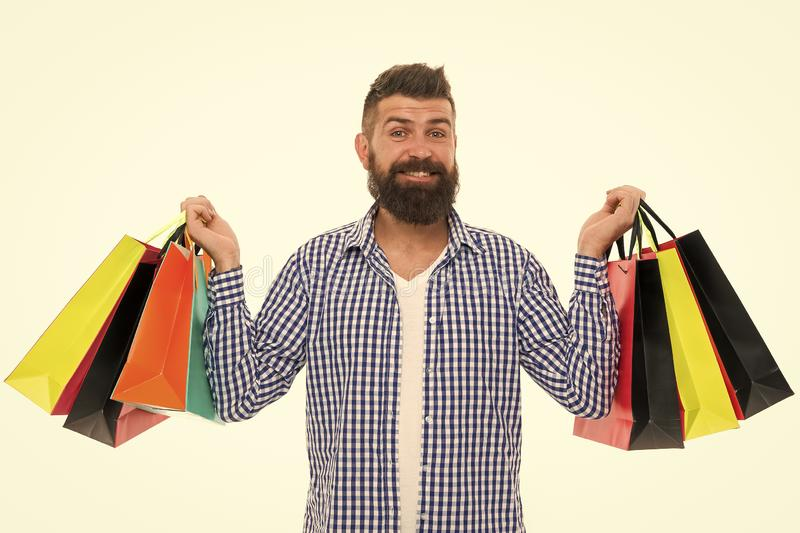 Brutal caucasian hipster with moustache. Bearded man with shopping bags.. Shopping sale. Male barber care. Black Friday stock photo