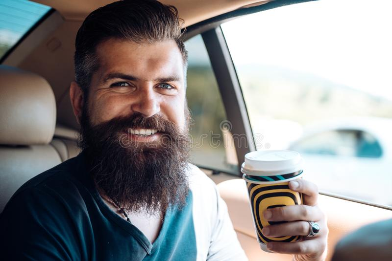 Brutal caucasian hipster with moustache. Male barber care. Mature hipster with beard. Bearded man. Enjoying morning royalty free stock images