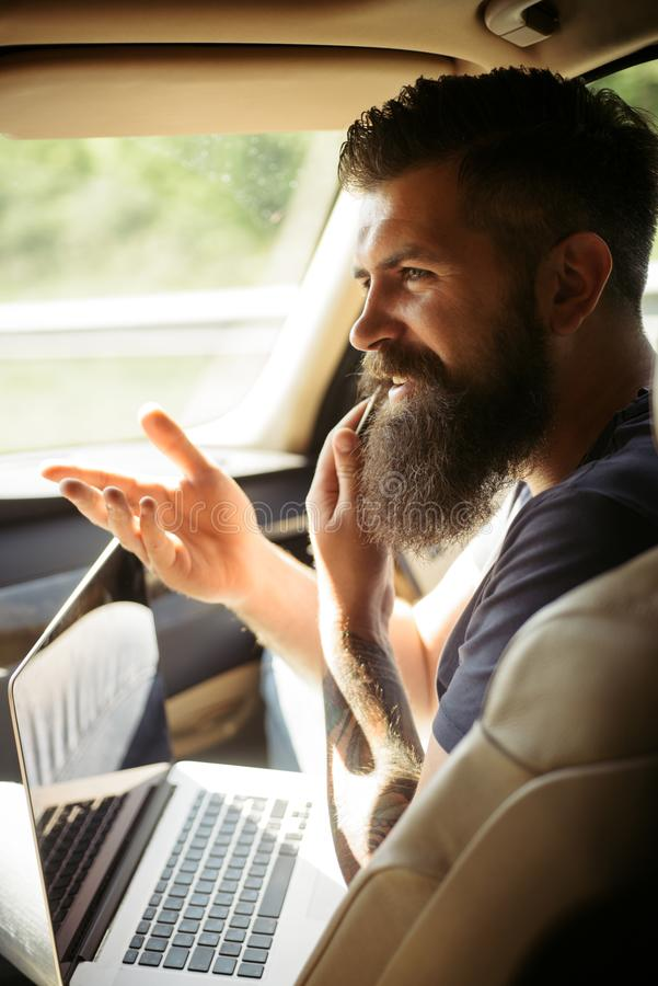 Brutal caucasian hipster with moustache. Male barber care. Mature hipster with beard. Taxi. traffic jam on road. time stock photos