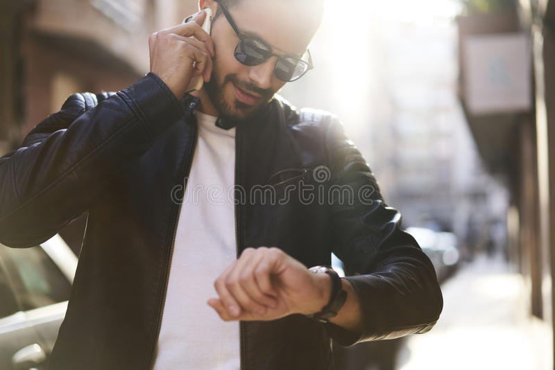 Brutal guy in a leather jacket and sunglasses stock photo