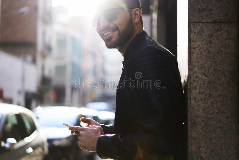 Brutal guy in a leather jacket and sunglasses stock images