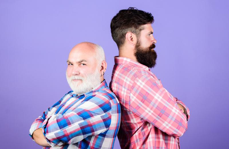 Brutal guys with long beard. Bearded friends. Hairdresser salon. Barbershop concept. Barber well groomed handsome. Bearded man. Father and son. Men bearded stock image