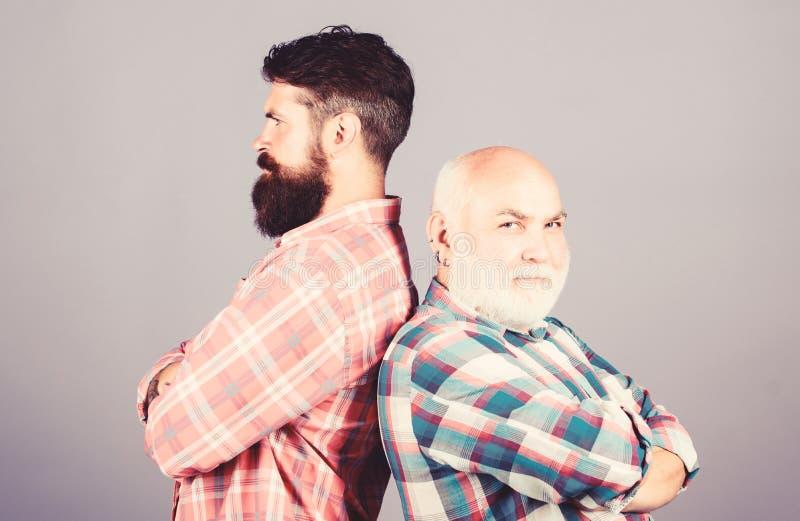 Brutal guys with long beard. Bearded friends. Hairdresser salon. Barbershop concept. Barber well groomed handsome stock image