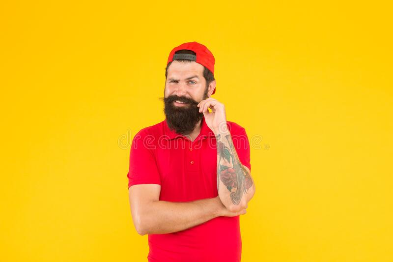 Brutal handsome hipster tattooed man. Bearded man trendy style. Hipster life. Beard and mustache grooming. Cool hipster royalty free stock images
