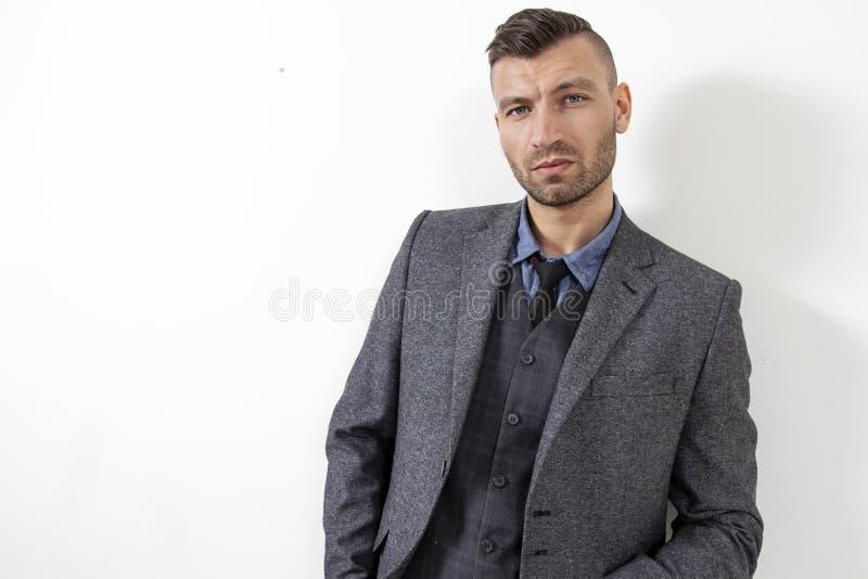Brutal handsome man in elegant suit. Portrait of confidence man. stock photo