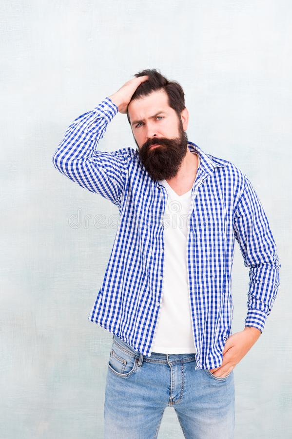 Brutal hipster with mustache. Mature hipster with beard. confident in his style. Bearded man thinking. Denim look. Male stock photos