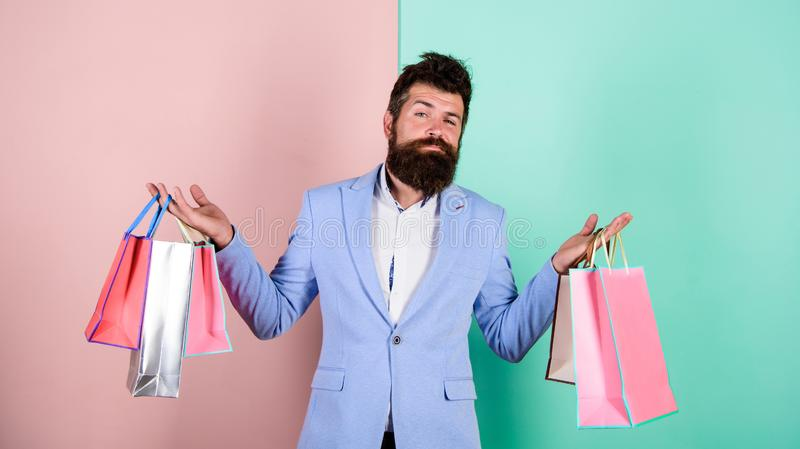 Brutal hipster shopper. big sale. male shopaholic hold shopping bags. present packages for holiday preparation. special. Offer on black friday. shop closeout stock image