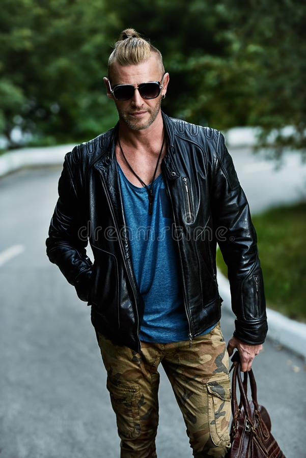 Brutal in leather jacket royalty free stock photos