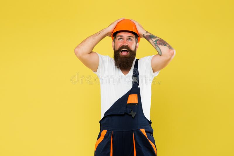 Brutal male worker. keep head safe in helmet. building is my passion. on construction site. repairman fix anything. man royalty free stock images