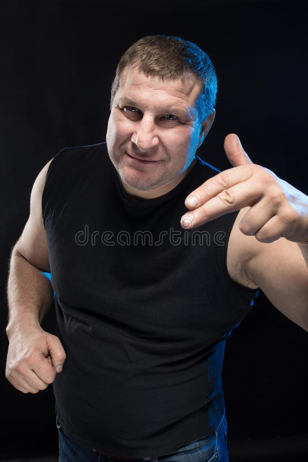 Download Brutal Man Actor Gesticulates And Grimaces. Stock Photo - Image: 83703904
