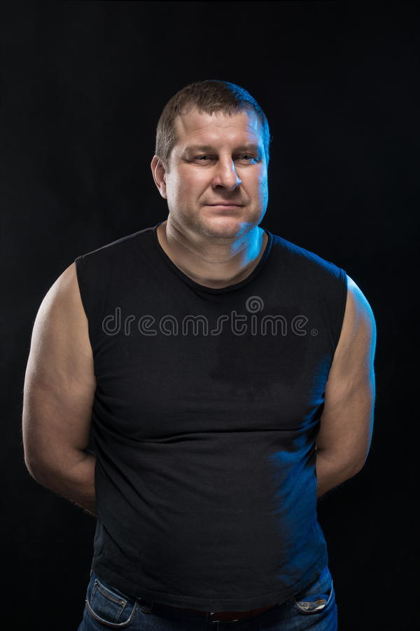 Download Brutal Man Actor Gesticulates And Grimaces. Stock Photo - Image: 83704135