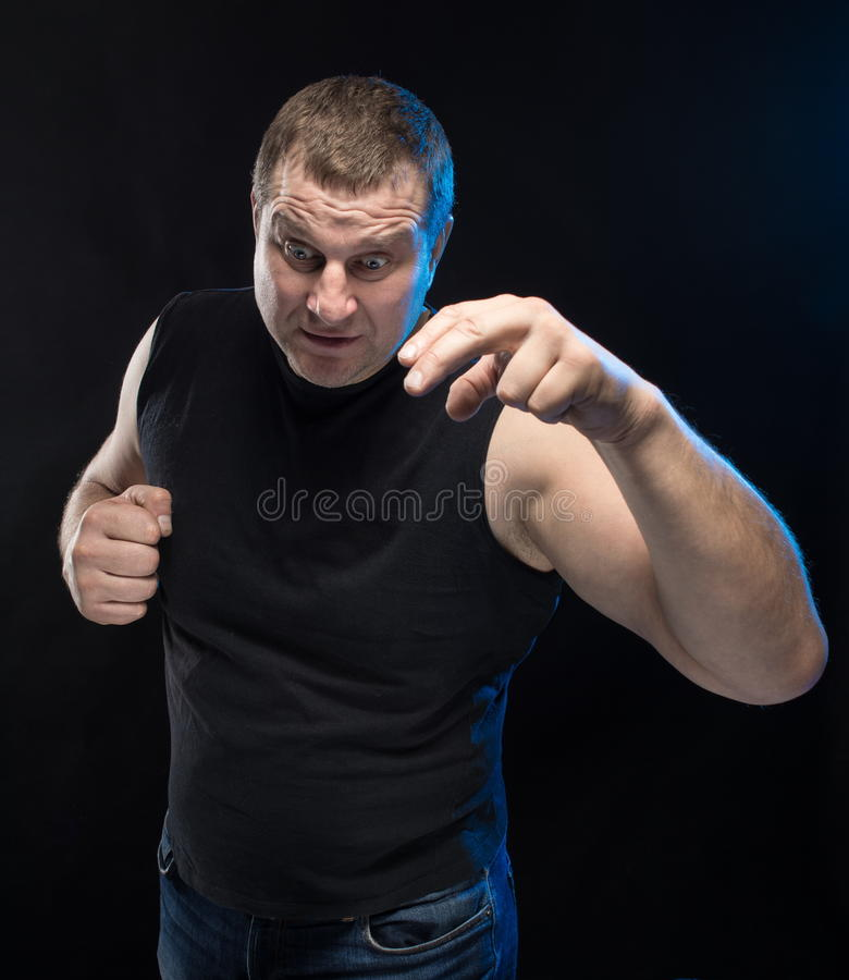 Download Brutal Man Actor Gesticulates And Grimaces. Stock Photo - Image: 83704274