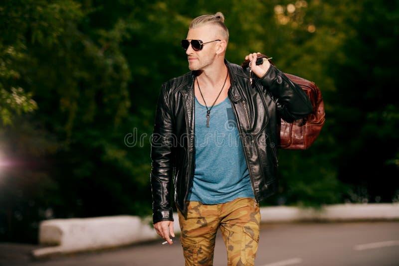 Brutal man in leather jacket stock image
