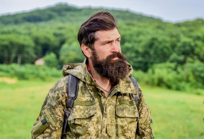 Brutal manly guy. Hike and travel. Weekend leisure and vacation. Hiker bearded man hiking. Hiker ready for adventures. Man bearded backpacker wear camouflage royalty free stock photos