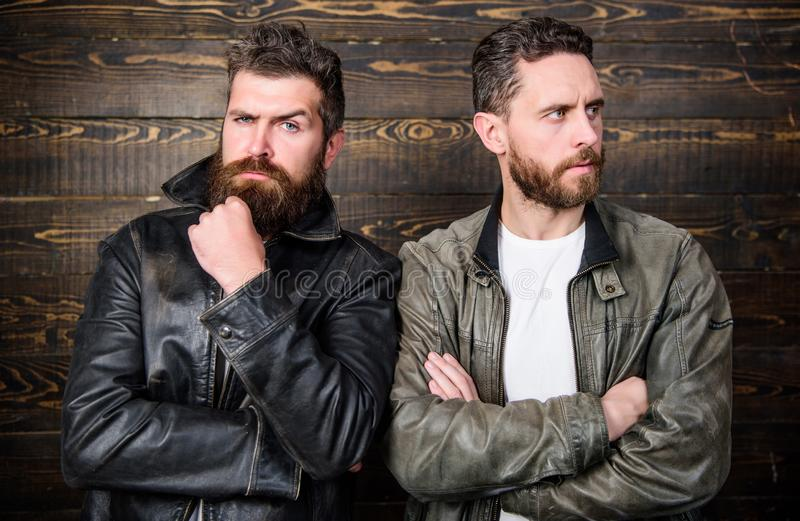 Brutal men wear leather jackets. Men brutal bearded hipster posing in fashionable black leather jackets. Leather fashion royalty free stock photo
