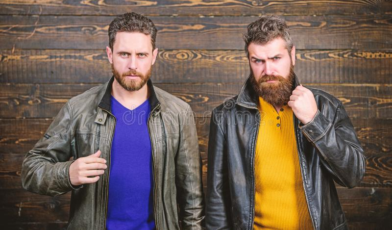 Brutal men wear leather jackets. Leather fashion menswear. Handsome stylish and cool. Feel confident in brutal leather. Clothes. Men brutal bearded hipster royalty free stock image