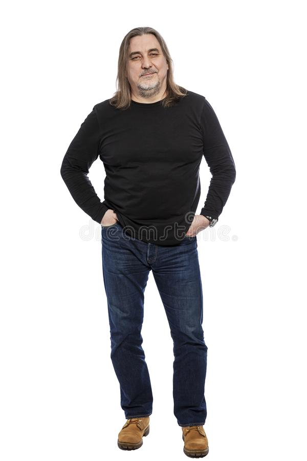 Brutal middle-aged man with long hair, full-length. Isolated on a white background. Vertical royalty free stock images