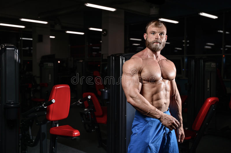 Brutal muscular man with beard unshaven fitness model healthcare royalty free stock photos