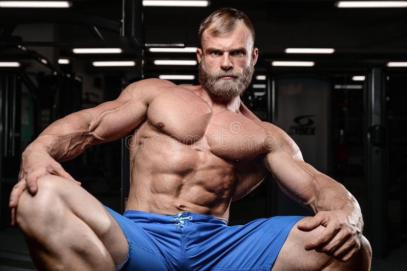 Brutal muscular man with beard unshaven fitness model healthcare. Brutal muscular man with beard train in the gym unshaven fitness model healthcare lifestyle royalty free stock image
