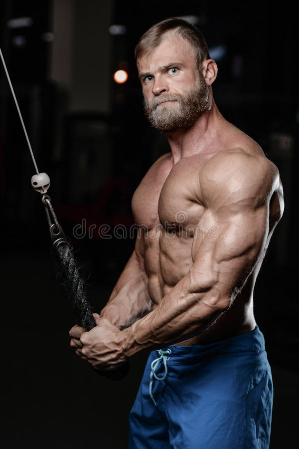 Brutal muscular man with beard unshaven fitness model healthcare stock images