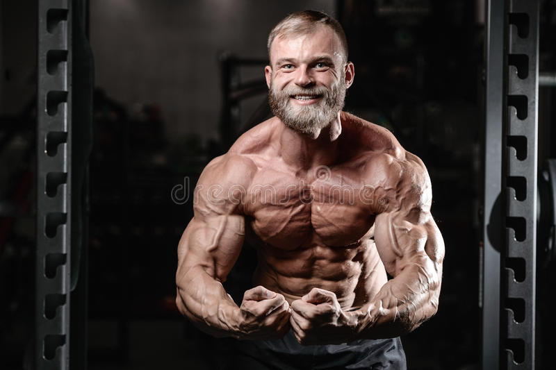 Brutal muscular man with beard unshaven fitness model healthcare stock photos