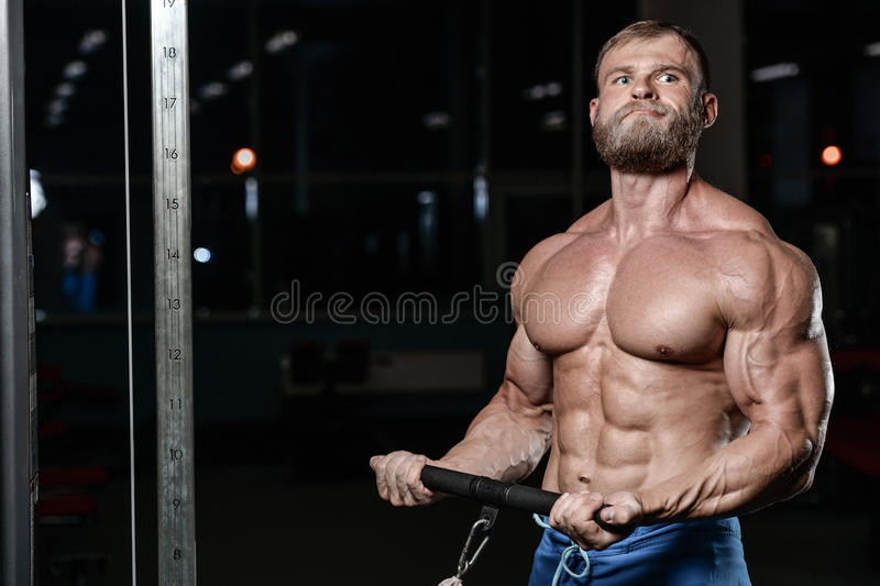 Brutal muscular man with beard unshaven fitness model healthcare royalty free stock photography