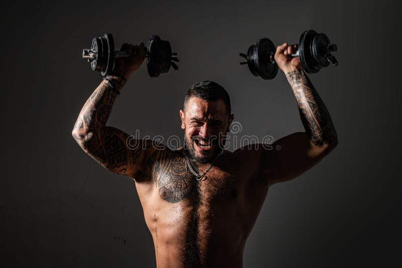 Brutal sportsman with barbell. steroids. confidence charisma. sexy abs of tattoo man. male fashion. muscular macho man. With athletic body. sport and fitness stock images