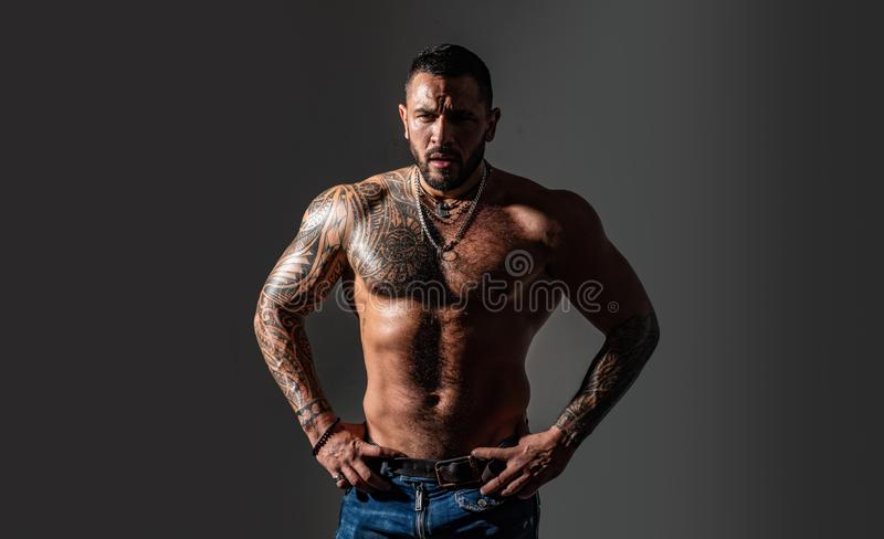 Brutal sportsman torso. steroids. sexy abs of tattoo man. male fashion. sport and fitness, health. confidence charisma. Muscular macho man with athletic body stock image