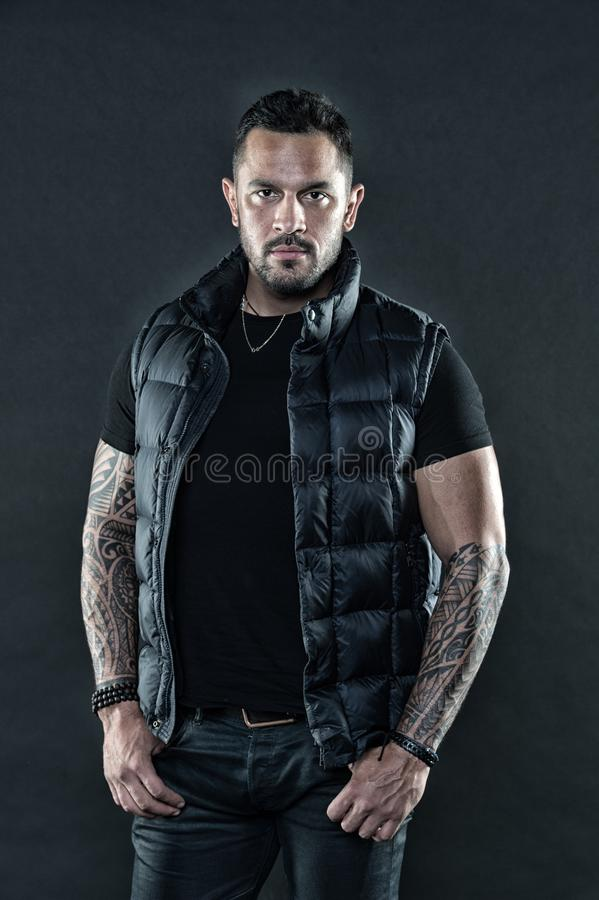 Brutal strict macho with tattoos. Masculinity and brutality. Tattoo brutal attribute. Tattoo culture concept. Man brutal. Unshaven hispanic appearance tattooed royalty free stock photography