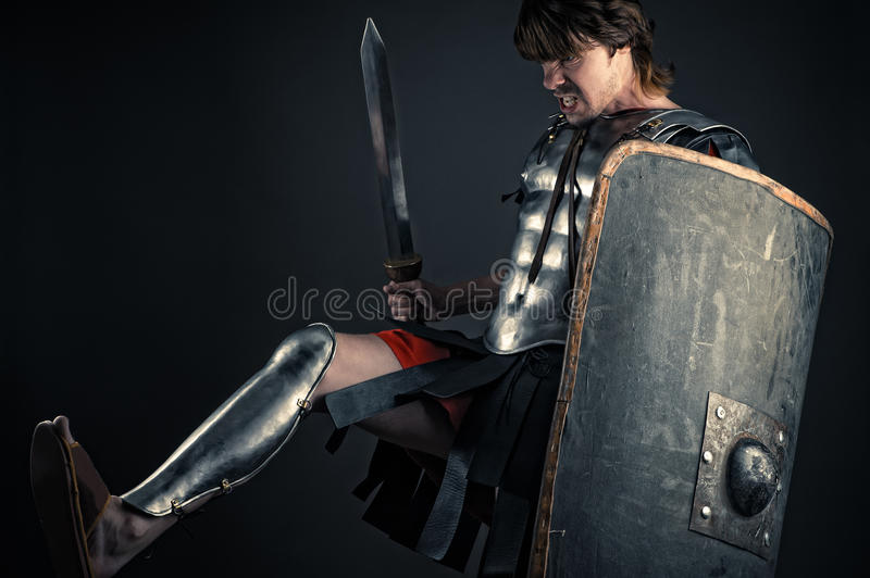 Brutal warrior of Sparta hits footed stock photos