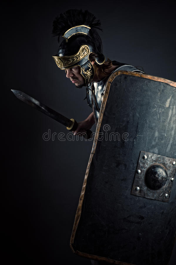 Brutal warrior with sword and shield royalty free stock photos