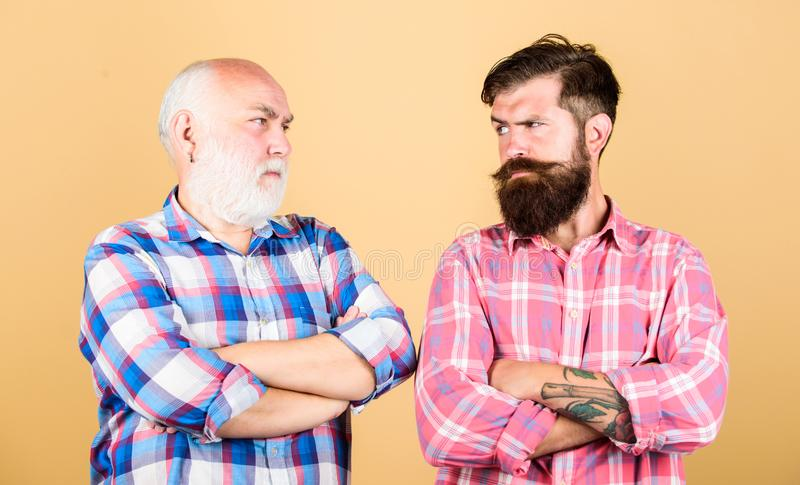 Brutality and masculinity. Bearded friends. Barber well groomed handsome mature man. Brutal barber with long beard. Father and son. Hairdresser salon royalty free stock photo