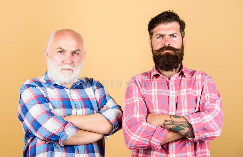 Brutality and masculinity. Brutal barber with long beard. Father and son. Hairdresser salon. Barbershop concept. Men stock photos