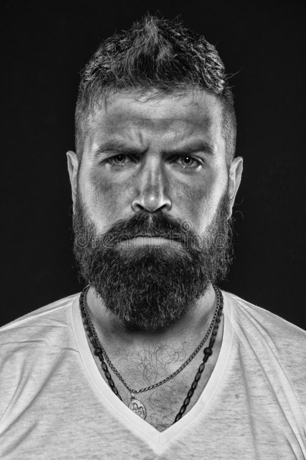 Brutality and masculinity. Man bearded hipster serious face close up. Brutal man with over suntanned skin face. Hipster. With beard and mustache looks strict stock images