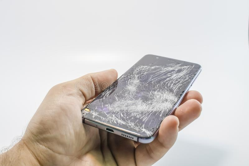 Bruten exponeringsglasmobiltelefon royaltyfri foto