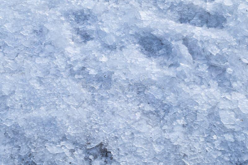 Bruten krossad bakgrund för isvintersnö arkivbilder