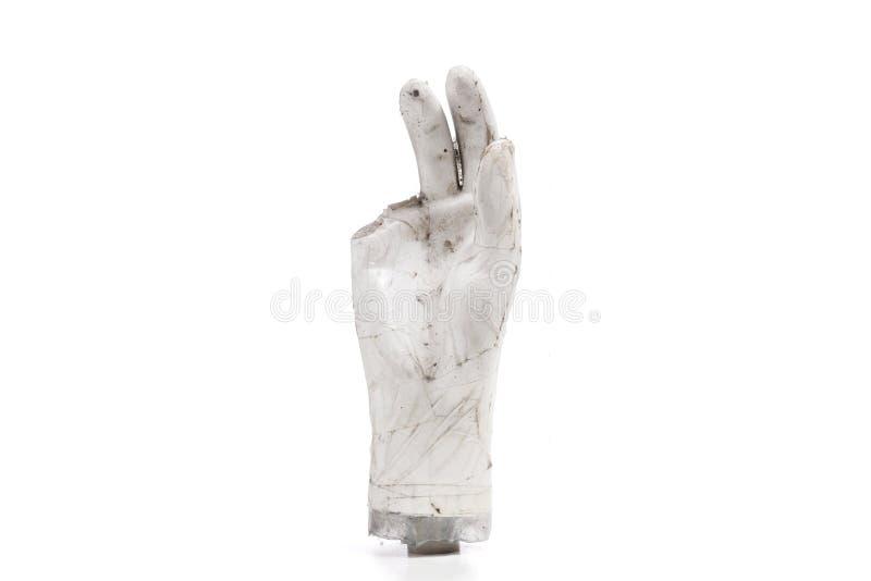 bruten och smutsig handdel av de manliga dockorna på en vit bakgrund arkivfoto