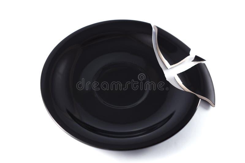 Bruten svart maträtt royaltyfri bild