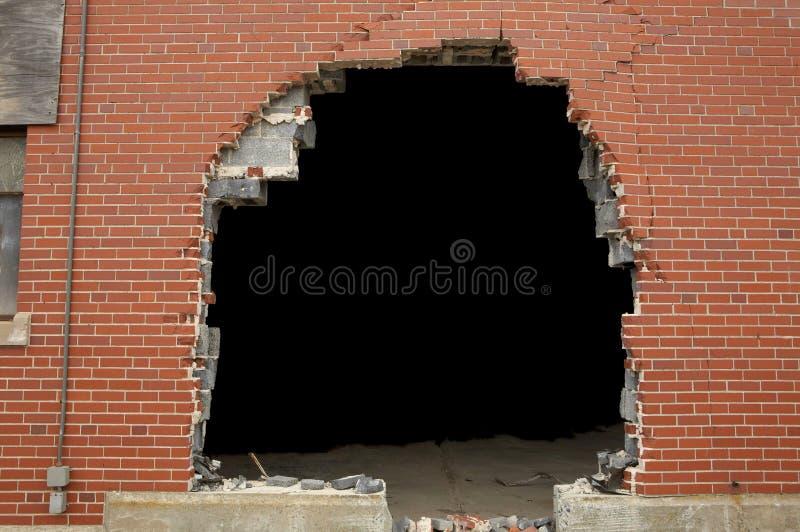bruten vägg för bakgrund tegelsten royaltyfri bild