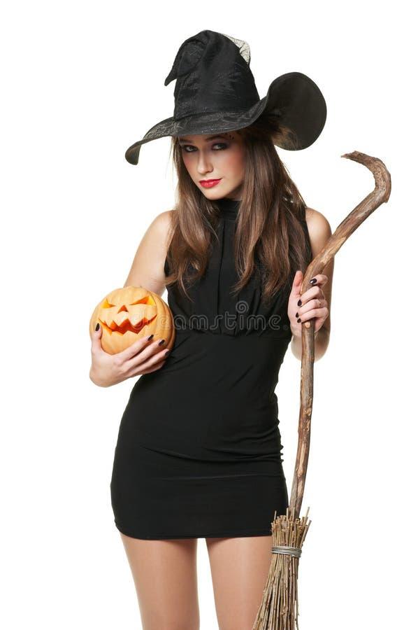 A bruxa agradável com uma vassoura fotos de stock royalty free
