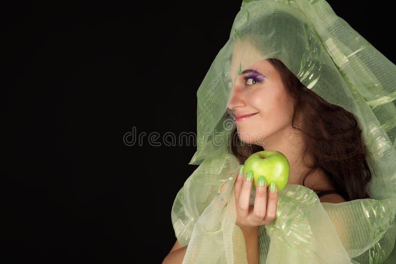 Bruxa do destreza com sorriso verde da maçã imagens de stock royalty free