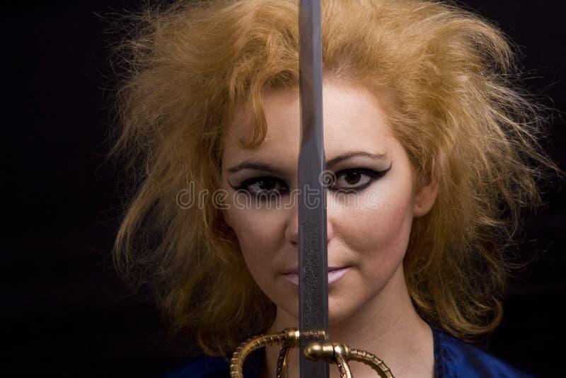 Bruxa horrívea com espada imagens de stock royalty free