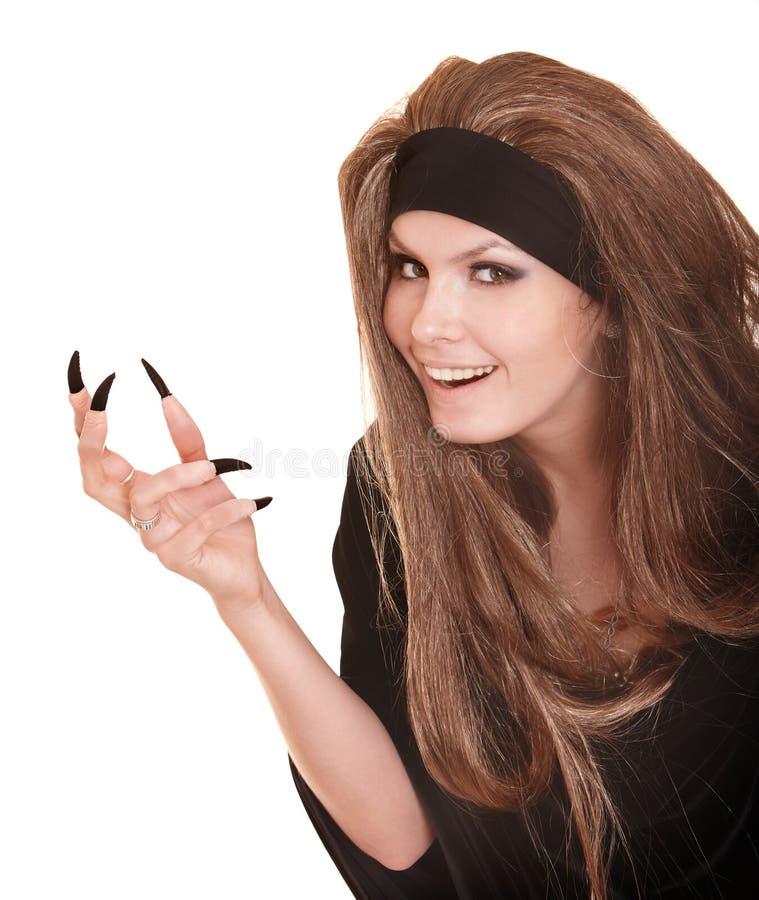 Bruxa no traje preto com dedo da garra. fotos de stock royalty free